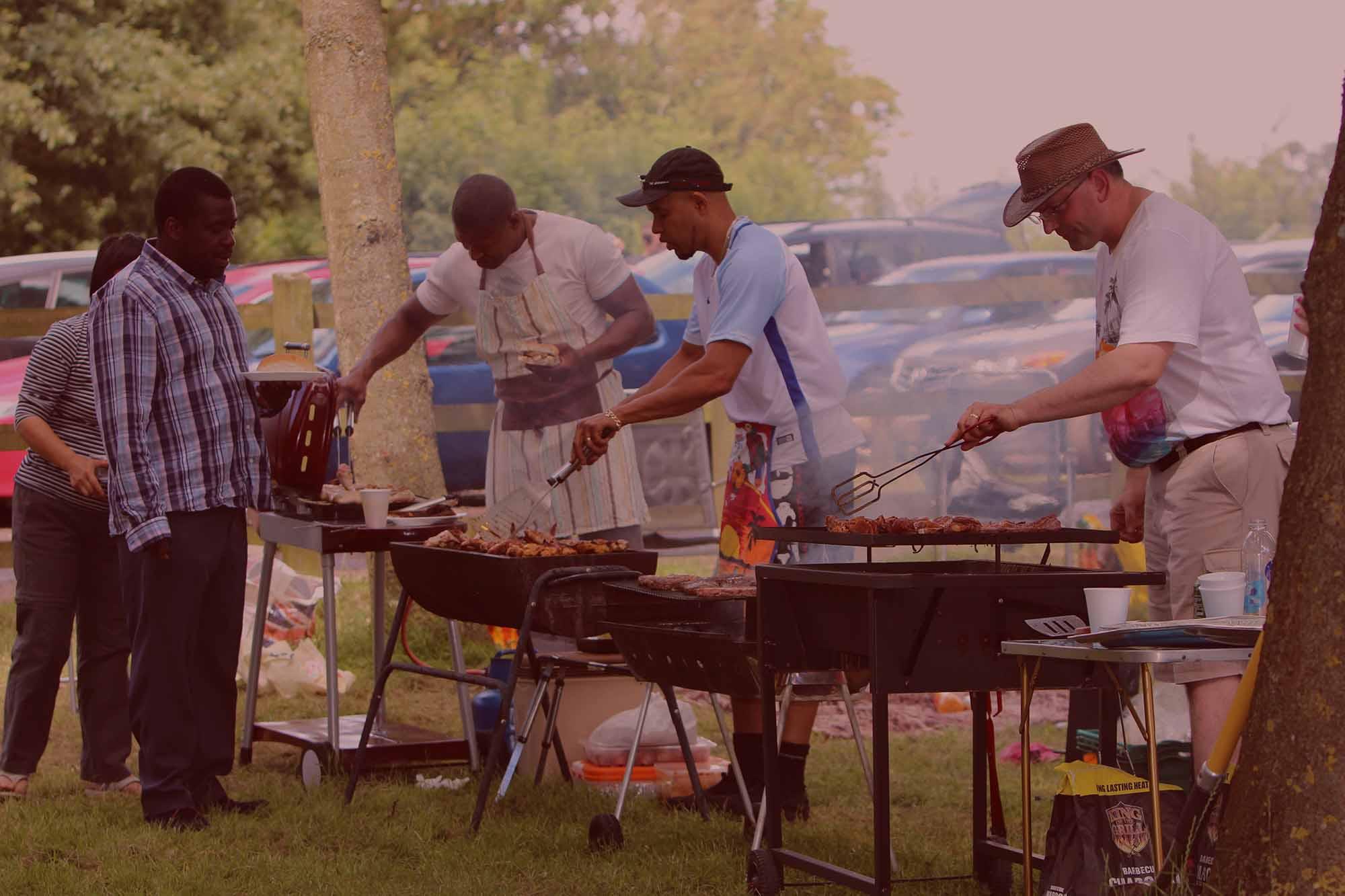 Men Cooking a BBQ